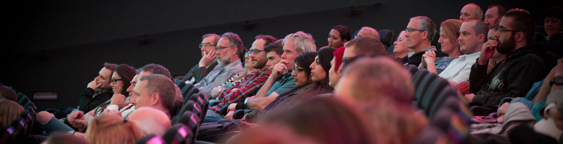 An audience listens to a speaker at a David Elder lecture in the Planetarium