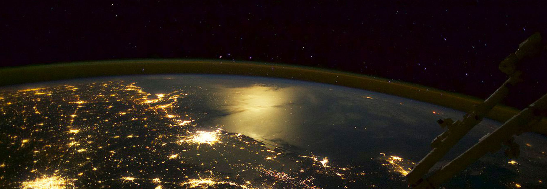 A still image from the Imax film 'A Beautiful Planet 3d' depicting earth from space with lights on showing the cities below