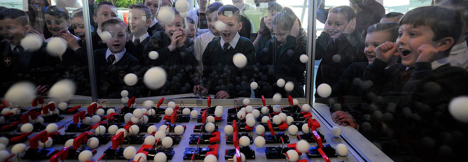 Pupils interact with our chain reaction exhibit in the Powering the Future Exhibition