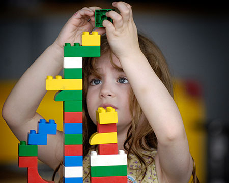 A young visitor plays with lego in our Big Explorer exhibition aimed at under 5s