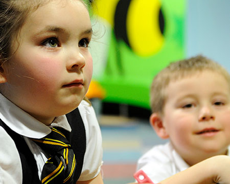 Two young visitors engage with the wonders of science at GSC
