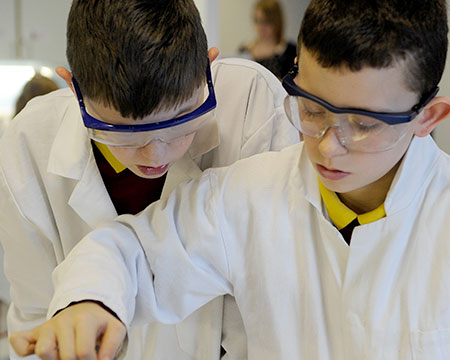 Two young scientists conduct an experiment in our lab area