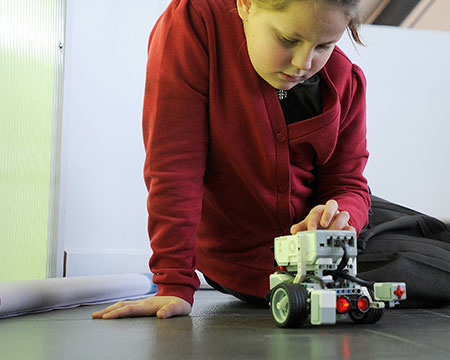 A pupil using the Lego Mindstorms equipment