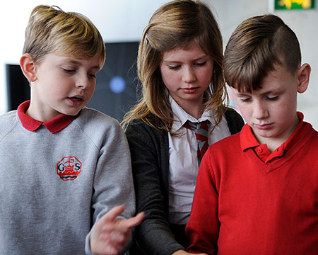 Two young boys and a girl investigate the wonders of science at GSC