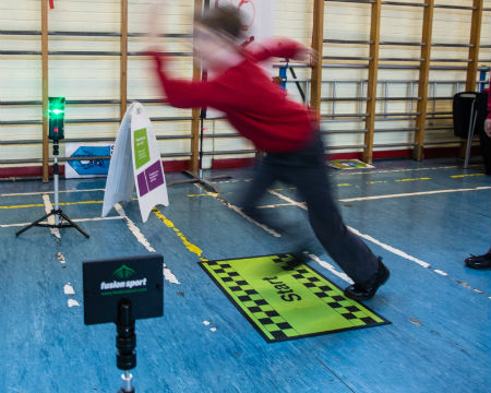 A pupil running through speed gates