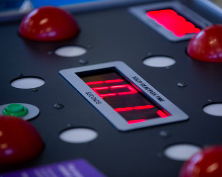 A close up of a reaction timer exhibit