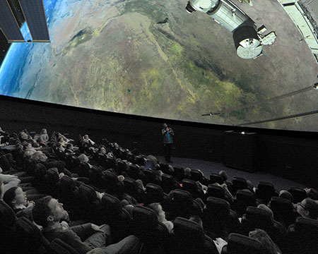 Live planetarium show with presenter talking to audience