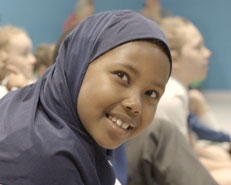 Smiling girl in early years workshop