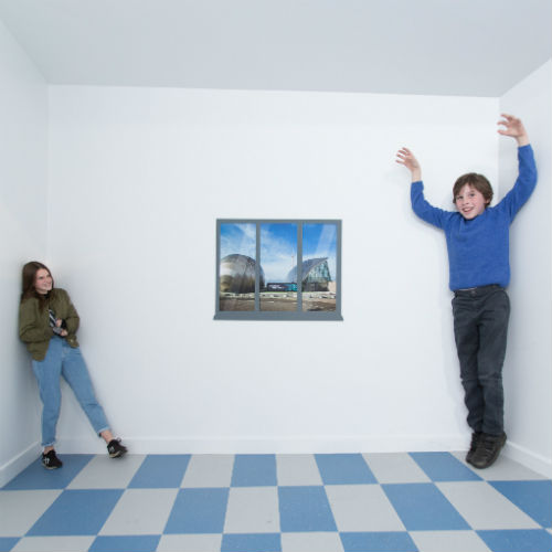 Young people in the Ames Room