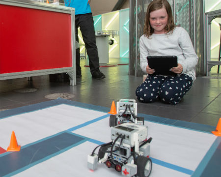 Girl playing with mindstorms robot