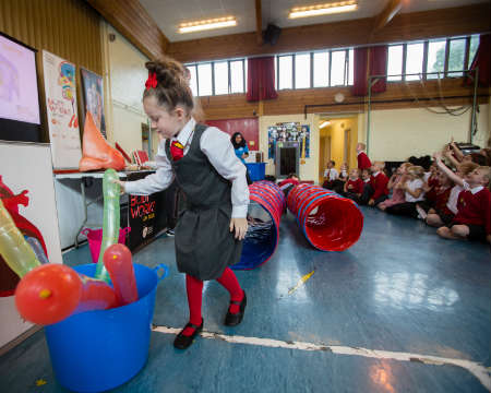 A school pupil with rocket balloons
