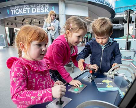 Ticket desk - children using exhibit