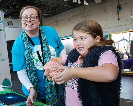 Girl holding a brain at Curiosity Live