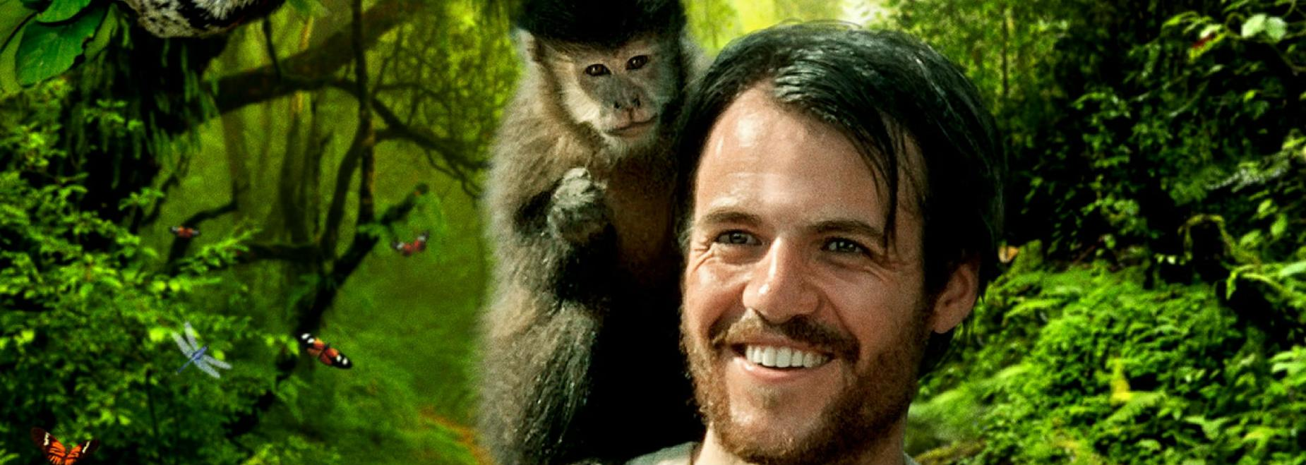 A still from the film showing Henry Bates in the jungle with a monkey on his shoulder