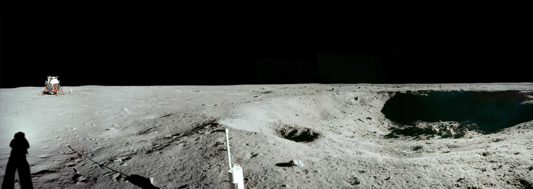 Apollo 11 East Crater with Eagle Lander in background. Credit: NASA