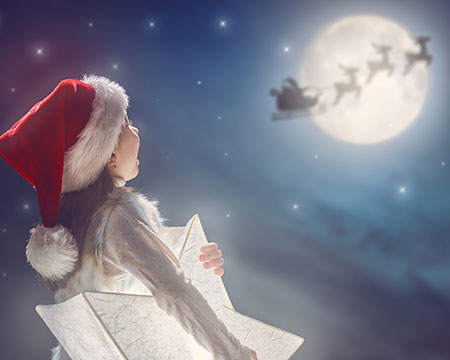 child watching santa fly past moon