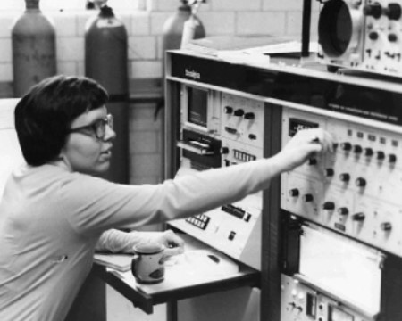 Female scientist working with gas chromatograph