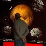 Man learning about the dwarf planet Pluto
