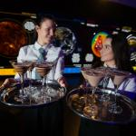 Space-themed cocktails being served in the Space Zone