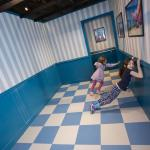 Children exploring the Ames Room