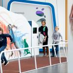 A young person races along the sprint track in the BodyWorks exhibition space.